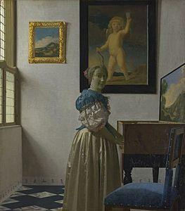 Afbeelding van onze reproductie van Staande virginaalspeelster by Johannes Vermeer op canvas, klein