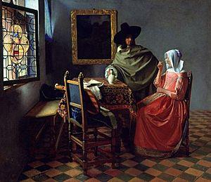 Afbeelding van onze reproductie van Het glas wijn by Johannes Vermeer op canvas, klein