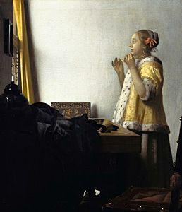 Afbeelding van onze reproductie van Vrouw met parelsnoer by Johannes Vermeer op canvas, klein
